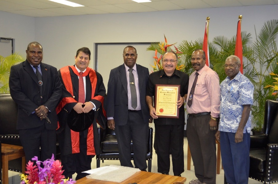 Left to Right: Mr Paul Dorpse, Executive Manager Corporate Services Department of Health, Prof Janek Ratnatunga, Dr Thaddeus Kambanei, The Honourable Peter O'Neill, Prime Minister of PNG, Rev. Joe Pandu, the General Superintendent of the Assemblies of God of PNG; Pastor John Apami, the Executive Officer of AOG PNG.